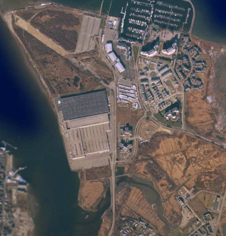 A late 1990s aerial view of Squantum did not show any remaining trace of  Dennison Airport (at the bottom-right of the photo).