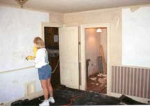 Kathy stripping wallpaper