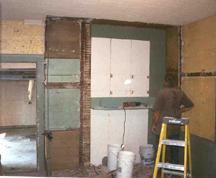 demolishing the huge closet/cabinet