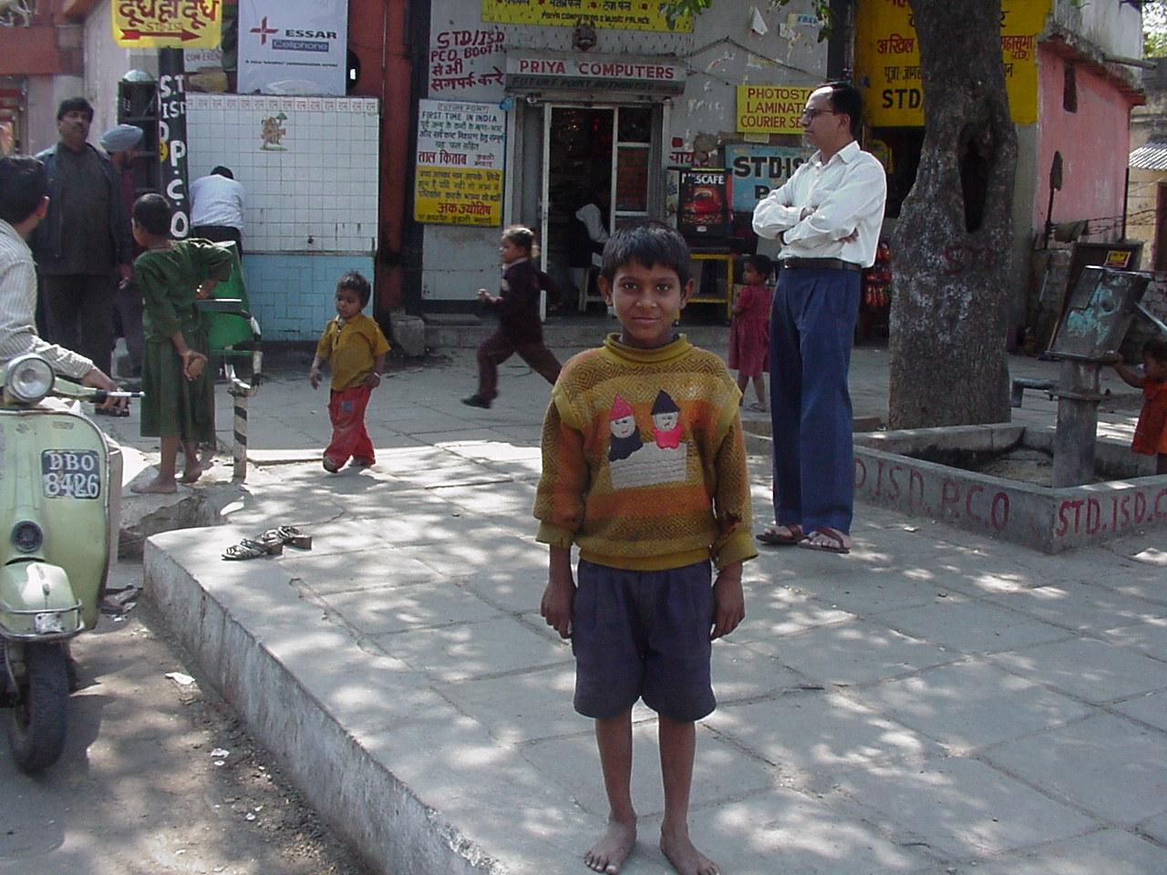 child begger posing for photo