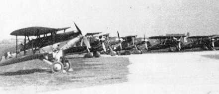 airfield with a Fairey Firefly in front