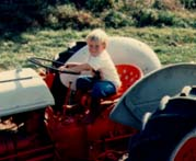 Having fun pretending to drive the 9N Ford farm tractor